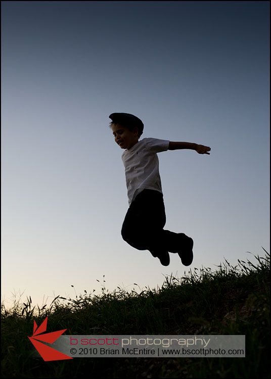 Photo: Silhouette of a young by jumping, set against the last deep blue color of an evening sky.
